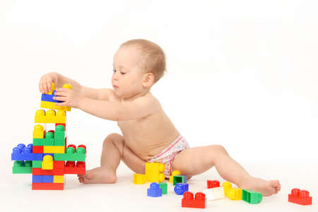 The small child plays the designer a white background Stock Photo - 4738939