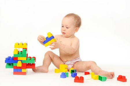 The small child plays the designer a white background Stock Photo - 4738949