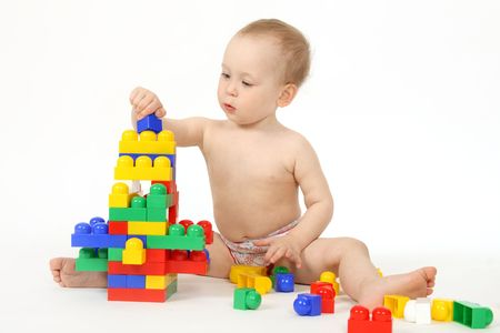 The small child plays the designer a white background Stock Photo - 4738974