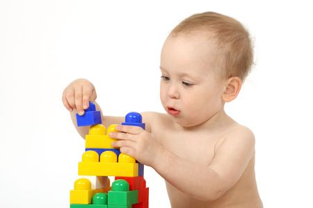 The small child plays the designer a white background Stock Photo - 4738945