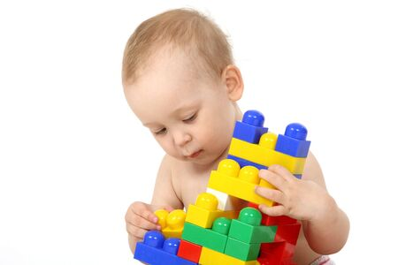 The small child plays the designer a white background Stock Photo - 4738954