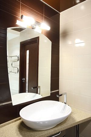 The beautiful modern bathroom finished with a tile