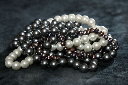 freshwater pearl: Three NECKLACES FROM pearls on a black velvet
