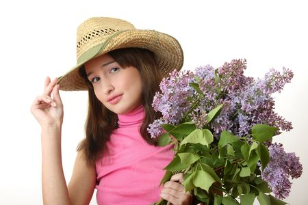 The young Girl with a lilac bouquet photo