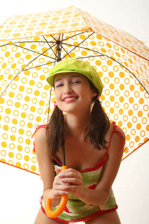 The girl in blue jeans with an umbrella photo