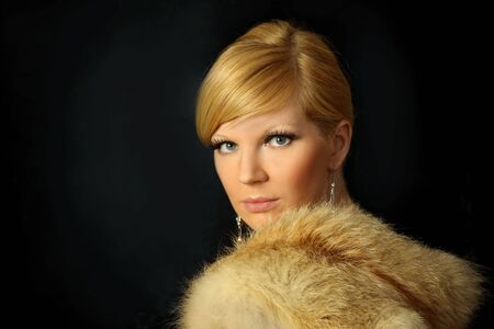 The beautiful girl in a fur coat