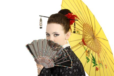 The Japanese geisha on a white background with a fan and an umbrella Stock Photo