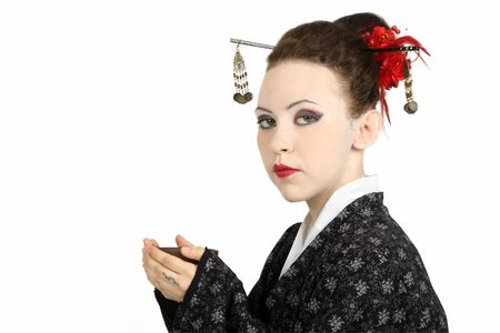 The Japanese geisha on a white background with a fan and an umbrella photo