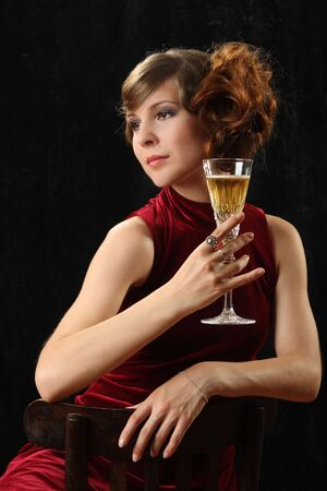 The beautiful girl with a wine glass Stock Photo