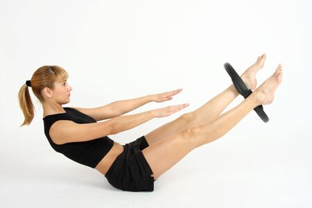 The girl, the instructor shows different exercises Stock Photo