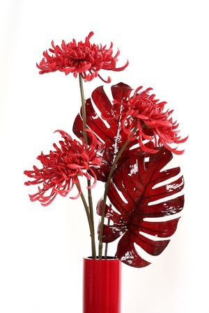 Bouquet in a vase from red artificial flowers