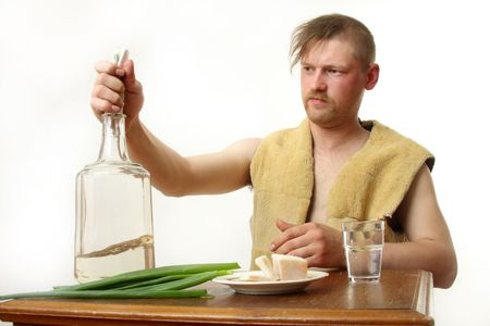drunkard: The man drinks moonshine and has a snack fat and an onions Stock Photo