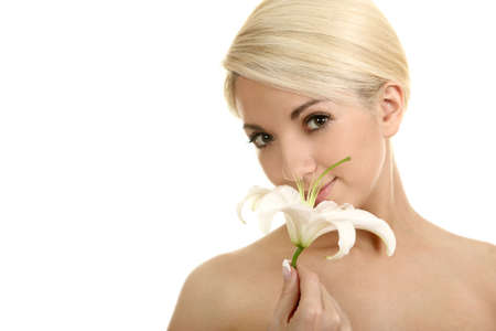 The beautiful girl, the blonde with a white lily on a white background