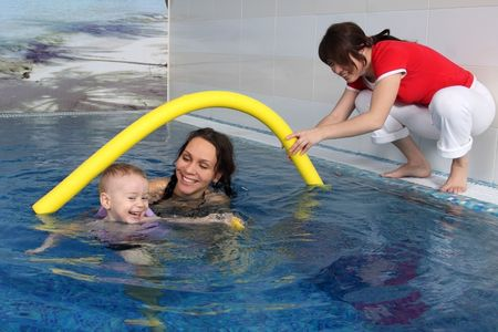 Mum with the son bathe in pool photo