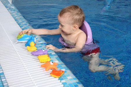 The little boy bathes in pool  photo
