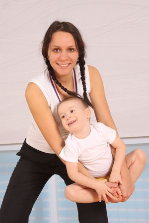 Mum with the son play a sports hall  photo