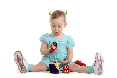 nested: The little girl with enthusiasm plays with Russian nested doll
