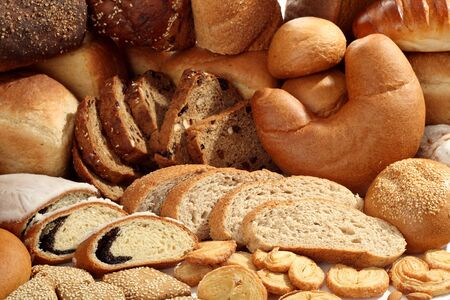 A lot of different bread on a white background photo