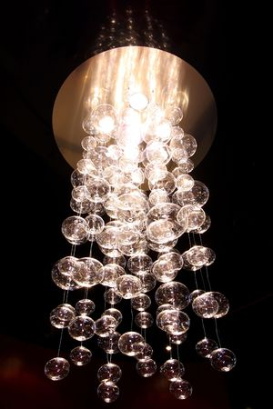 The beautiful decorative chandelier hanging on a ceiling