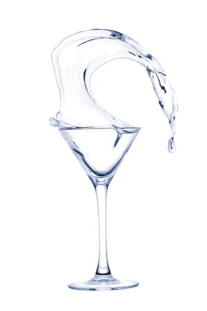 Freakish splashes transparent at its finest from a glass for martini close up.