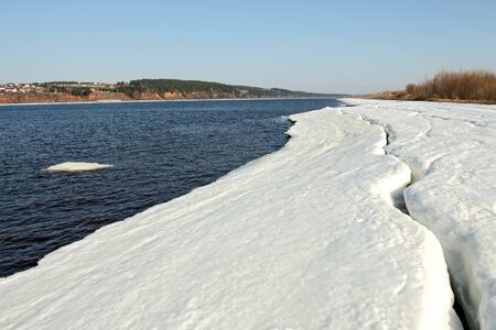 kama: Early spring. Ice on river bank Kama. Russia, the Udmurt republic.