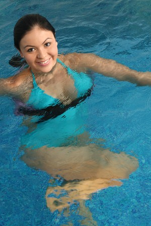 Employment with pregnant women in small pool photo