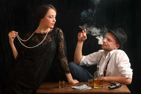 The man-gangster and the beautiful girl talk in a bar Stock Photo - 8068066