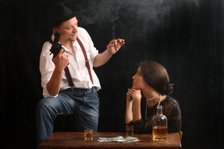 The man-gangster and the beautiful girl talk in a bar