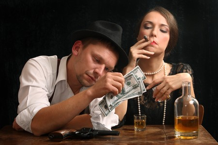 cigar smoking woman: The man-gangster and the beautiful girl talk in a bar
