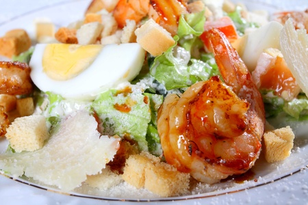 Salad from tiger shrimps, cheese and greens photo