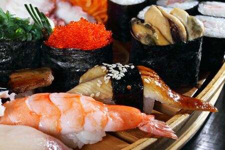 Japanese cuisine from rice and seafood in the big assortment Stock Photo - 8736030