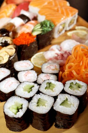 Japanese cuisine from rice and seafood in the big assortment Stock Photo - 9296109
