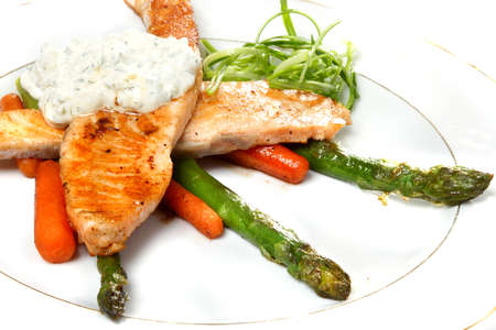 Two pieces of a fried salmon with carrots and an asparagus Stock Photo - 9323063