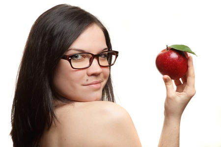 The beautiful girl wearing spectacles with an apple in a hand on a white background photo