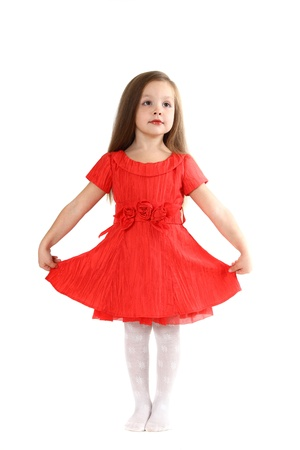 The little girl in brightly red dress on a white background Stock Photo