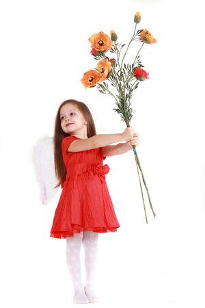 The little girl in brightly red dress on a white background has control over a bouquet of poppies