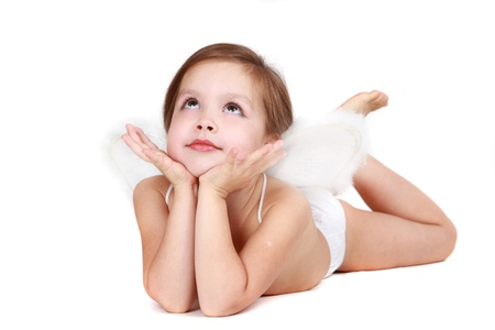 The beautiful four-year girl with angelic wings behind the back on a white background photo