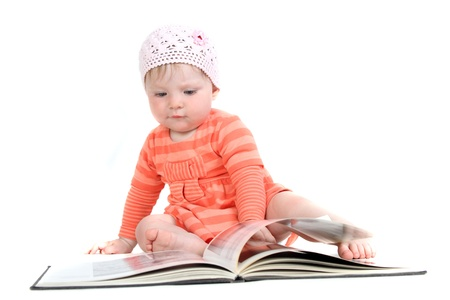 The little blue-eyed girl thumbs through the book. A portrait on a white background. Option 2. Stock Photo