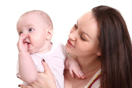 babie: Young mum and the small son, portrait on a white background close up, the kid holds a finger in a mouth, a format horizontal.