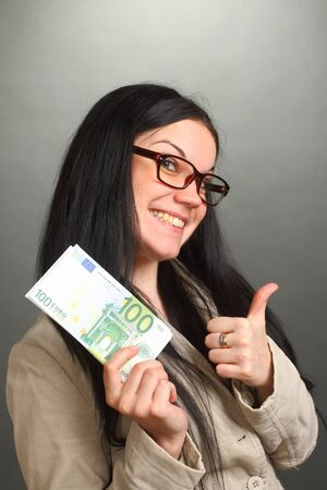 bacon portrait: the girl the brunette wearing spectacles holds a roll of money