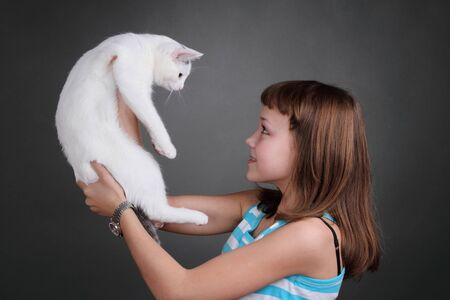 the girl and white cat play. close up. double 14 Stock Photo - 13334361