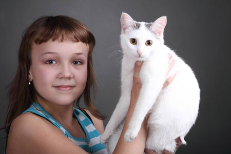 the girl and white cat play. close up. double 11 Stock Photo - 13334350