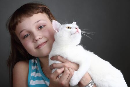 the girl and white cat play  close up  double 2 Stock Photo - 13334364