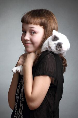 the girl and white cat play  close up  double 5 photo