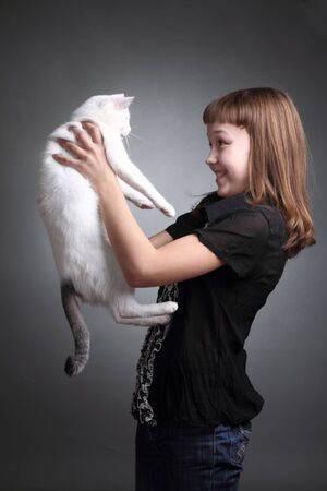 the girl and white cat play  close up  double 4 photo