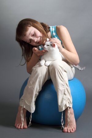 the girl and white cat play  close up  double 15 photo