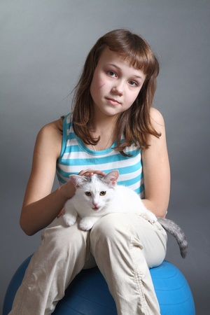 the girl and white cat play  close up  double 16 photo