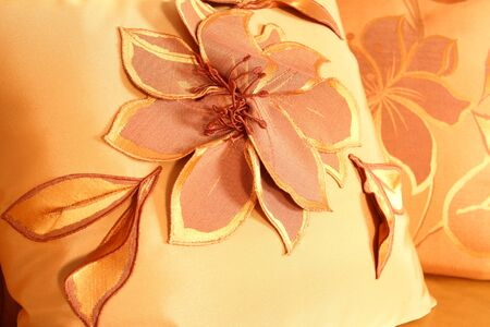 fragment of a divanny pillow with the embroidered flower from tulle photo