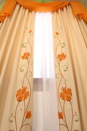 transparent dress: curtain fragment with the embroidered vegetative ornament, a vertical Stock Photo