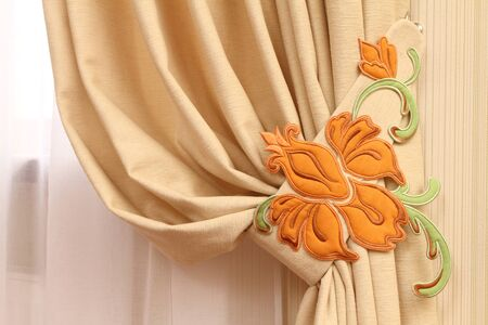 fragment of a window curtain with the embroidered vegetative ornament, a horizontal shot photo